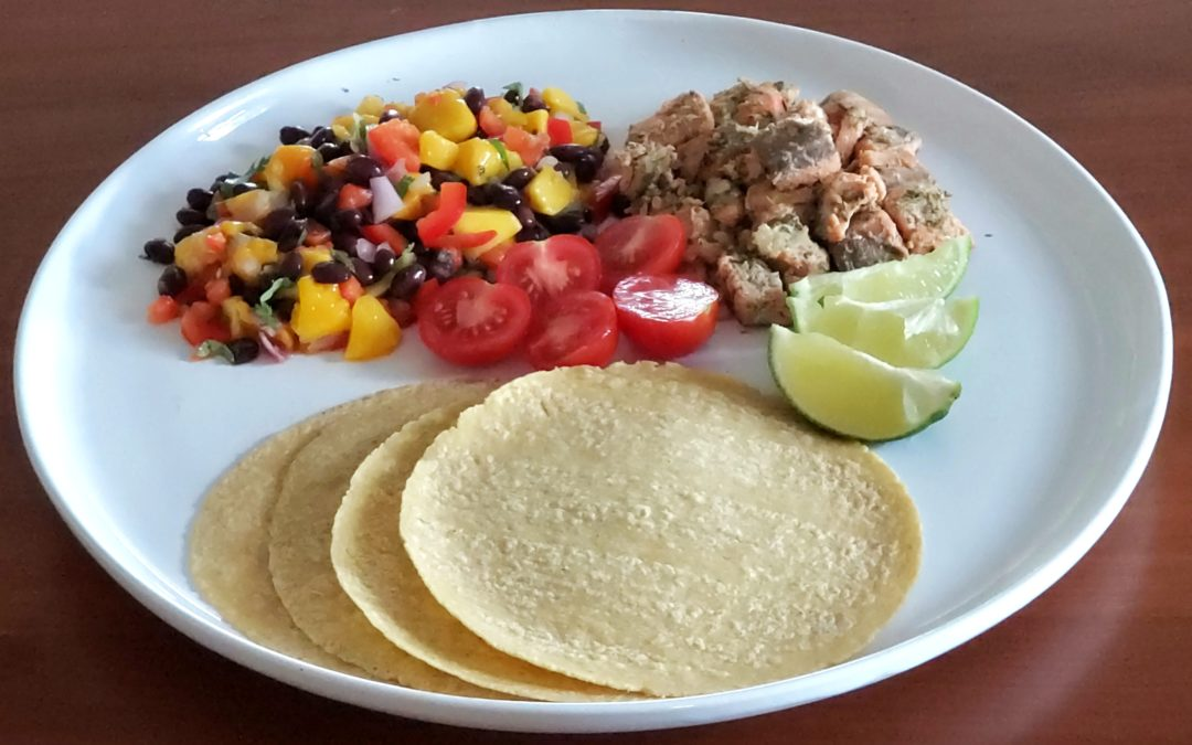 Grilled salmon tacos with mango-black bean salad